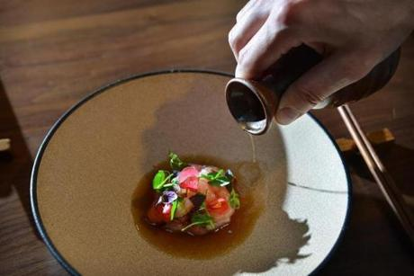 Ama Ebi (sweet shrimp, Maine), with burnt ginger oil, shiso, and smoked beef bone consomm�, prepared by Chef Tony Messina at Uni Sashimi bar in Boston. Josh Reynolds for The Boston Globe (Names, smartc)